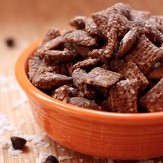 Almond Joy Puppy Chow  1 c powdered sugar  1 c shredded sweetened coconut flakes  8 c Chex (any variety)  2 c unsalted almonds  1 c semi-sweet chocolate chips  1/2 c almond butter  4 T coconut oil* (see note below)  1 t vanilla extract