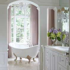 Change out jetted for a claw foot... Wow!! Talk about a fairytale bathroom! Designed by Anthony Como.  #bathroom #bathroomdesign #luxuryhomes #luxurybathroom #interiordesign #clawfoottub #tiledesign #soakingtub #fairytalebathroom