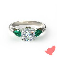 A stunning and unique 14K white gold three stone pear shaped emerald engagement ring.