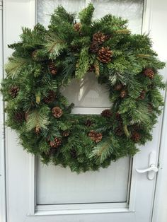 Pinecone with Pine & Cedar Greens Winter Wreath - Wreaths By Julie - - With its Simplistic appearance this winter wreath will add beauty to any door or fireplace. It features natural pinecones cedar and pine surrounded by lush balsam greens. Christmas Crafts, Christmas Decorations, Christmas Ornaments, Holiday Decor, Christmas Movies, Wreaths For Front Door, Holiday Wreaths, Fresh Christmas Wreaths, Winter Wreaths