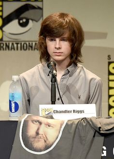 He looks so serious in this picture Chandler Riggs I love him