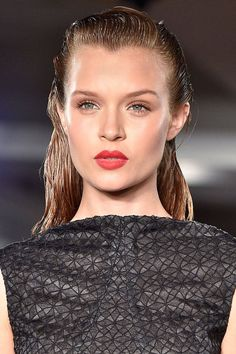 """The """"out of the water look"""" is shiny and slick. Whether your hair is up in a tight bun or hanging down by your shoulders, any degree of wetness creates a bold look."""