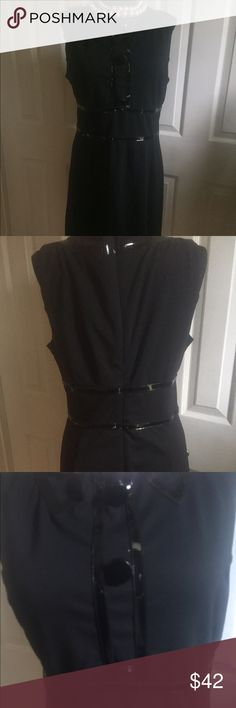 MICHAEL KORS WOMAN's BLACK DRESS MICHAEL KORS woman's black dress rn#111818; ca#45885; made of shell; polyester; rayon  and spandex with lining. Pre-owned good condition; stylish, made-on leather faux collar, streams and waist line of the same(size, 6). KORS Michael Kors Dresses Asymmetrical