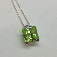 STERLING SILVER AND GREEN STONE NECKLACE Sterling silver 925, necklace with square green stone. Jewelry Necklaces