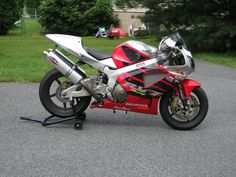 They never got the exhausts right. Eother not parellel to the seat,too far adrift or too much pipe work. Needs alot of thought. Round Termis might be the answer with custom titanium pipes.