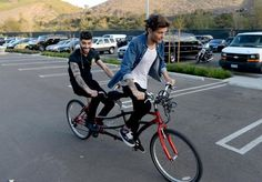 Louis and Zayn riding a bike outside today!