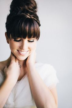 Topknot Wedding Hairstyle With Bangs