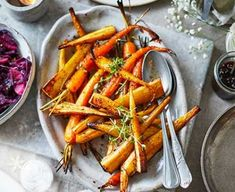 ngredients parsnips, peeled and cut into finger-length pieces, tough cores removed baby carrots, scrubbed 3 tbsp olive oil 2 tbsp maple syrup tbsp good-quality vegan white wine vinegar handful thyme, leaves picked Roasted Potato Recipes, Roasted Vegetable Recipes, Roasted Root Vegetables, Vegetable Dishes, Veggies, Vegan Christmas, Christmas Recipes, Christmas Menus, Christmas Foods