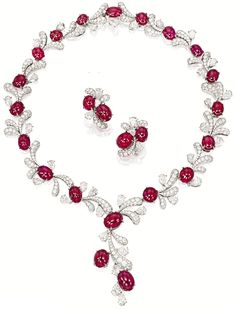 Ruby and diamond fireworks set by James W. Curren for Faidee. -The necklace contains 20 cabochon rubies totaling and cts of pear-shaped and brilliant cut diamonds. Via Diamonds in the Library. Ruby Necklace, Ruby Jewelry, Ruby Earrings, Jewelry Sets, Diamond Jewelry, Jewelery, Jewelry Accessories, Jewelry Necklaces, Fine Jewelry