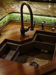 Very unique custom corner sink made of domestic copper by Rachiele. www.Rachiele.com