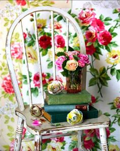 floral wallpaper and old chair