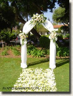 Garden Arch with white draping and flowers