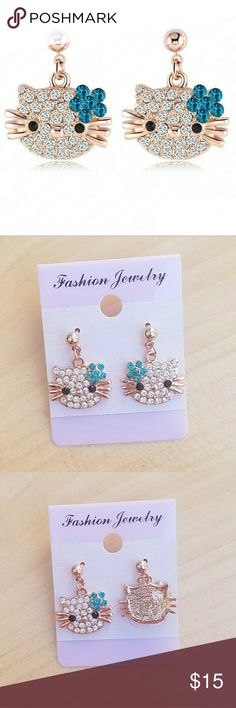 Hello Kitty Blue Austrian Crystal Earrings Triple 18k rose gold plated over zinc alloy with genuine high quality Austrian crystals set in a pierced back earring setting.  Measures: 21 mm wide 17 mm high Hello Kitty Jewelry Earrings