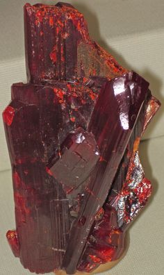 Long used as a poison, realgar, or arsenic sulfide, is not something you want to ingest. While rare in gem quality and difficult to facet, the intense red to orange-red color of realgar has made its way into some gem collections. With proper precautions, realgar could make an assembled jewelry stone. However, when handling this gem, avoid contact with water or steam, which can release toxic fumes. Furthermore, with a low melting point, avoid heat sources. Be sure to store realgar away from…