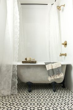 Instead of opting for a pricier custom tub, Jenna Sue purchased a basic white porcelain and cast iron claw foot tub to replace the bathroom's golden yellow fibreglass tub-shower combo. She then painted it a warm gray color to achieve the look she was aimi Bathroom Renos, Bathroom Renovations, Small Bathroom, Washroom, White Bathroom, Modern Bathroom, Bathroom Ideas, Clawfoot Tub Bathroom, Bathroom Bin