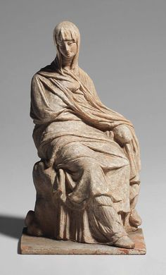 A GREEK TERRACOTTA FIGURE OF A WOMAN TANAGRA, HELLENISTIC PERIOD, CIRCA 3RD CENTURY B.C. Price realised USD 134,500 Estimate USD 80,000 - USD 120,000 Ancient Greek Clothing, Greece Culture, Hellenistic Period, Greek Pottery, Greek History, Ancient Greece, Terracotta, Medieval, Sculptures