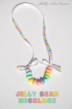 Jelly Bean Necklace Chewy, fruity and gooey on the inside. Hard candy coating on the outside. It& the shape and size of a kidney bean, but in all the colors of the rainbow. A Jelly Bean! Easter Crafts, Holiday Crafts, Holiday Fun, Fun Crafts, Easter Ideas, Holiday Ideas, Edible Crafts, Easter Candy, Hoppy Easter