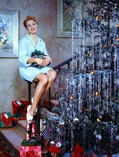 Shirley Jones, perched on her stair railing, why didn't I think of that?