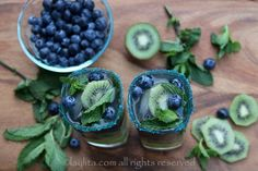 Recipe for kiwi blueberry mojito cocktails made with fresh kiwis, blueberries, lime, mint leaves, sparkling water and rum.