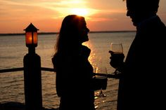Unwind with a glass of wine before enjoying a romantic dinner at sunset in the East Wharf area of Lake Hefner in Oklahoma City.