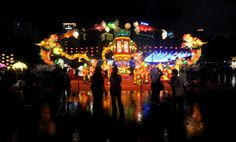 People look at an exhibit at a Chinese Lantern Festival event in Beijing. The exhibit depicts many traditional elements of Chinese culture, including a dragon and a period palace lamp