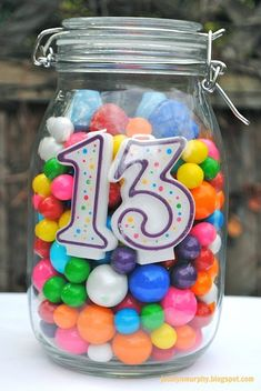 'Birthday centerpiece idea for any age -- tie balloons on top--fill with any candy.'