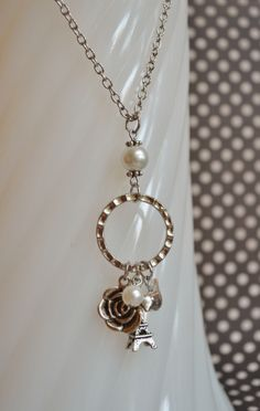 Paris inspired long antique silver necklace w/ rose, Eiffel Tower, bird and white glass pearls.