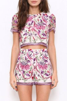 A two-piece set featuring floral embroidery detailing all throughout. Round neckline. Short sleeves. High-waist. Finished hem. Zipper back closure.    Floral Embroidered Set by L'atiste. Clothing - Matching Sets Florida