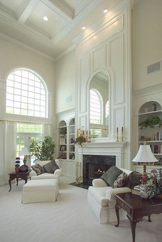 Image result for tall ceiling fireplace with bookcases on either side