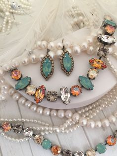 Items similar to CHEYENNE earrings. Marquise, Navette, Lever back, dangle drop, Crystal Halo Earrings. on Etsy Diamond Solitaire Earrings, Opal Earrings, Round Cut Diamond, Modern Jewelry, Fashion Necklace, Turquoise Necklace, Beaded Jewelry, Swarovski Crystals, Dangles