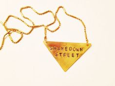 """Stamped Metal Triangle Pendant Necklace: Grateful Dead Song - """"Shakedown Street"""""""