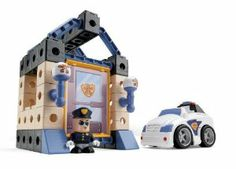 """Fisher Price TRIO Police Station by Fisher Price. $16.89. Double-sided snap-in picture panels let kids change their city adventures. Build a world of city adventure. Kids can build and rebuild their own police station lock-ups. 37 pcs Included - Build up to 4 city adventures. Figure can """"drive"""" the police car that kids build themselves. From the Manufacturer                Build a world of city adventure! Easy-click bricks, sticks, and panels let kids build and rebuild their ..."""