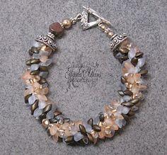 Kumihimo. Love the magatama long beads