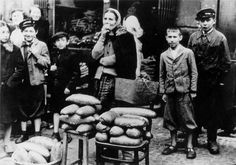Warsaw, Poland, Bread sales next to a bakery in the ghetto, 1939.