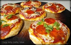Quick recipe for mini pizzas using Pillsbury Grands! biscuits! Great for busy back-to-school evenings. Adding this to my recipe file!