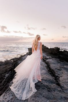 Fall in love with this romantic destination sunset elopement session at Mosteiros Beach in San Miguel. #destinationengagement #romanticweddingdresses #bridalportrait #weddingphotography #uniqueweddings #realweddings