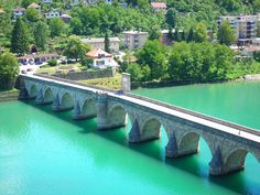 The Mehmed Paša Sokolović Bridge (Serbian: Most Mehmed-paše Sokolovića Serbian Cyrillic: Мост Мехмед Паше Соколовића) over the Drina River, located in Višegrad, Bosnia and Herzegovina Oh The Places You'll Go, Places To Travel, Travel Destinations, Places To Visit, Travel Around The World, Around The Worlds, Monumental Architecture, Bosnia And Herzegovina, World Heritage Sites