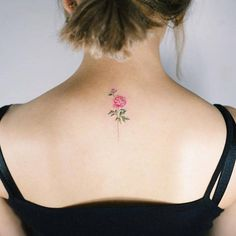 Pink peony tattoo on the upper back. Tattoo artist: Sol Tattoo