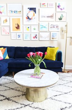 The marble-topped coffee table pairs well with a blue velvet Peggy sectional in Philadelphia-based blogger, Rachel Smith's colorful living room!