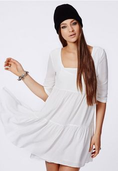 It's a smock off this season with the classic #smockdress style making its mark as a key piece for #AW. This beaut #chiffon #boho feel #dress features an effortless loose fit shape with three quarter length sleeves with a fully lined finish. Channel #bohemian vibes with its #floaty, #tiered style and wear with a fedora hat, a touch of #Missguided faux fur and lace up boots.