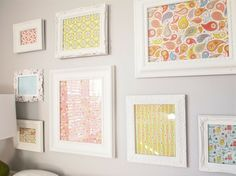 Framed fabric idea for foyer: spray paint frames that you have in different shapes and sizes in white.