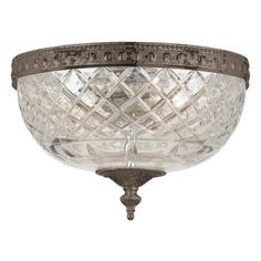 Bring a touch of classic elegance to your home with this flush mount Richmond ceiling light, finished in English bronze. The glass globe is crafted of 24-percent clear lead crystal, creating a bright illumination and a dazzling effect.