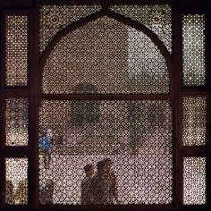 Islamic Screen - originally started to be used to prevent people outside from seeing the faces of the women inside. Like a burca...
