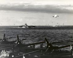 Taken from USS Hornet (CV-12) on 14 May 1945 - Jap plane exploding after being struck by gun fire of Task Group 58-1; USS Bennington (CV-20) in foreground.