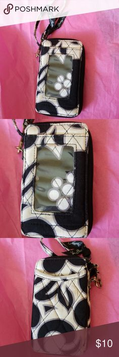 Vera Bradley Small Wristlet Has ID Pocket in front. It is off white gray and black. Several pockets for money and cards with a coin zipper pocket. Great for festivals or shopping hands free. It is in used condition has a couple of small stains shows some signs of wear. I just throw my Vera Bradley's in the washer when they get dirt on them. This shows some signs of wear.  Hints the low price see pics for flaws. No rips just minnor signs of wear. Vera Bradley Bags Clutches & Wristlets