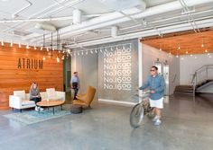VARA / Studio O+A. concrete floors, waiting area, wall graphic, open ceiling, wood ceiling