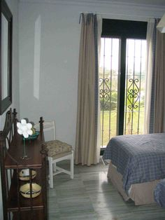 The apartment has two double bedrooms, fully equipped with linens, towels, iron, and everything you might need