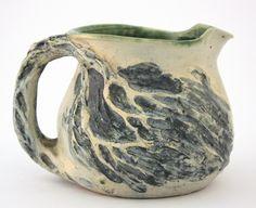 Merric Boyd Pottery jug with windswept landscape design.