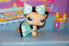 New Littlest Pet Shop Custom made accessories. Auction Includes Bow, Skirt, Necklace, & Earrings.