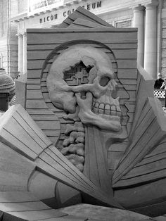 sand sculpture: 'Homo Binarus' by fergus mulvany